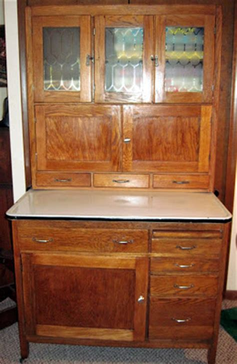 my hoosier cabinet it originally belonged to my great tracy s toys and some other stuff 1916 hoosier cabinet