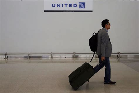 united flight baggage fee united airlines to restrict low fare flyers to one carry