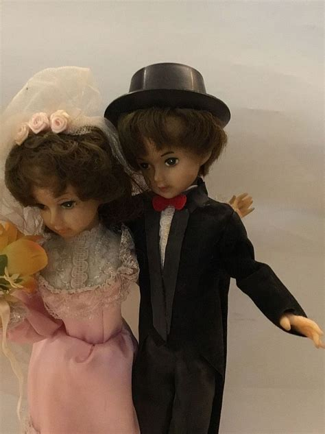 groom rubber st groom and pair of dolls approx 25cm high stand on rubb