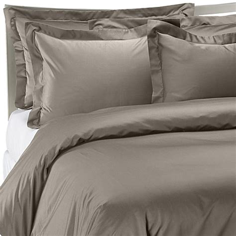 palais royale hotel collection duvet cover in stone bed