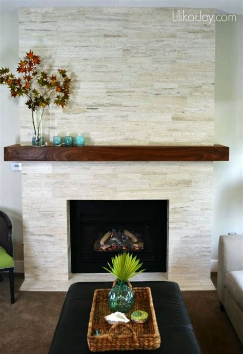 family room fireplace makeover with travertine tiles