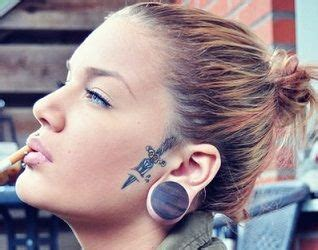 small facial tattoos small knife jpg 318 215 250 tattoos and