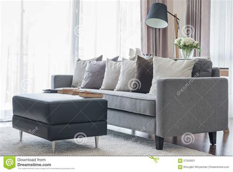 Living Room Chair Pillows Modern Grey Sofa With Pillows And Black Table In Living