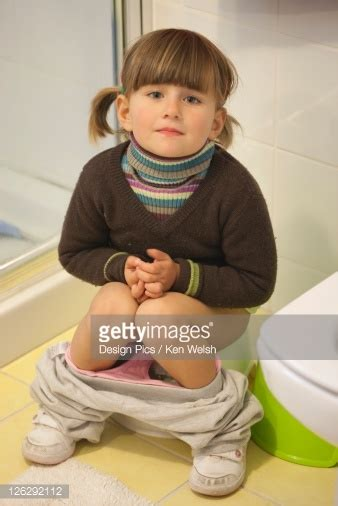 girl on toilet potty training threeyearold girl toilet training stock photo getty images