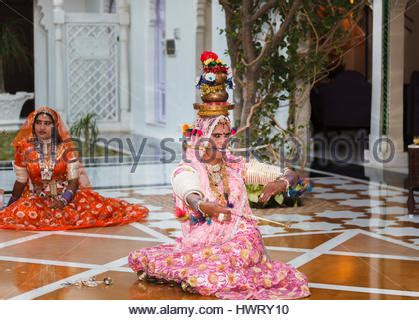 indian dancers in traditional garment mudras