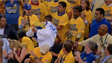 stephen curry fan stephen curry dives into crowd warriors fans don t catch