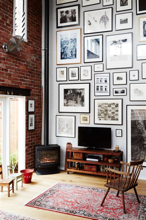 wall decor for high ceilings living space with high ceilings exposed brick and a