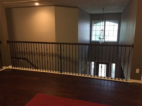 replace banister with half wall replacing half wall with wrought iron balusters angela east