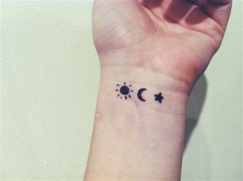 moon and star henna tattoo a plain and simple looking symbols of a sun and a