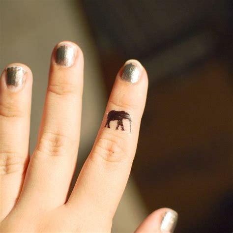 elephant tattoo on finger 1000 ideas about elephant finger tattoo on pinterest