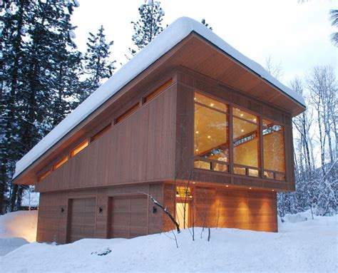 Garage under house designs garage modern with slant roof tall windows tall windows