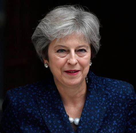 theresa may may warns eu not to treat uk unfairly in