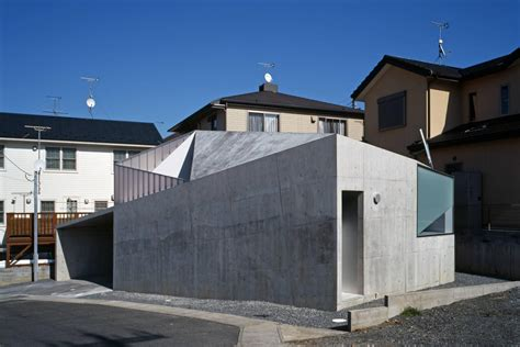 built with modern concrete house built on a budget and featuring an irregular shape