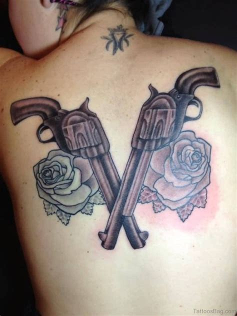 revolver tattoo design 64 ultra modern gun tattoos for back