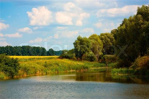 Landscape Photography Overexposed Sky Countryside Landscape With Small Lake And Sky Stock