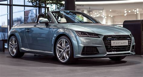 audi exclusive tt roadster in morning dew green pearl effect hue poses in showroom