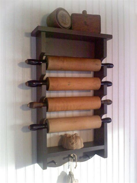 primitive rolling pin rack with pegs wooden country