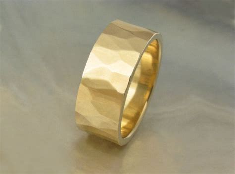 7mm wedding band hand hammered in sustainable 14k yellow gold