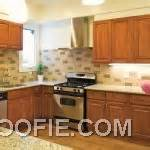 pretty tile kitchen backsplash with artistic painting