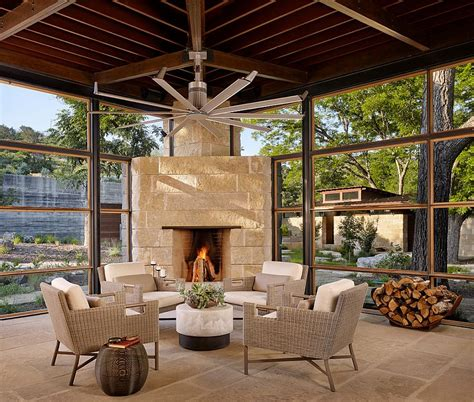 Sunroom With Fireplace by Cozy Sunroom With A Limestone Fireplace Decoist