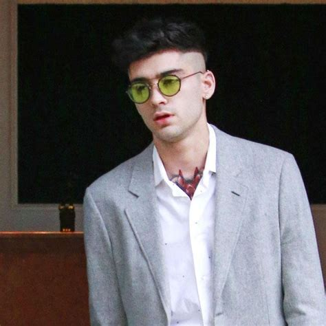 zayn malik shares hint of chest tattoo