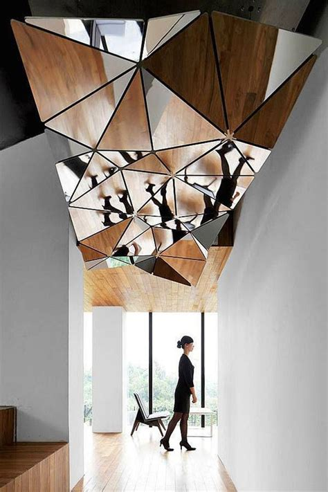 cool ceilings picture of complex mirror structure on a ceiling is a