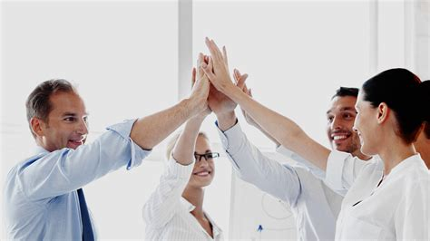 how to a to high five happy business team giving high five may busch