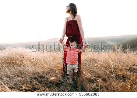 mom walks in on boy dressed as a girl funny as it gets mother holding child stock images royalty free images