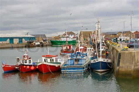 fishing boat jobs northern ireland fishing boats docked in the howth harbor ireland stock