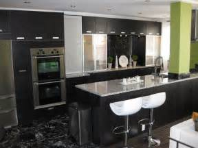 exceptional Modern Kitchens With Islands Ideas #6: RMS_ruffingit-small-apartment-kitchen-modern-black-green_s4x3.jpg.rend.hgtvcom.1280.960.jpeg