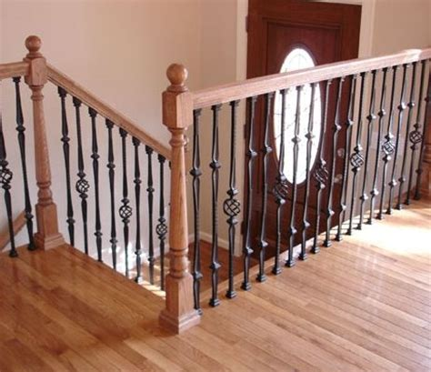 wrought iron and wood stair railings for a split foyer