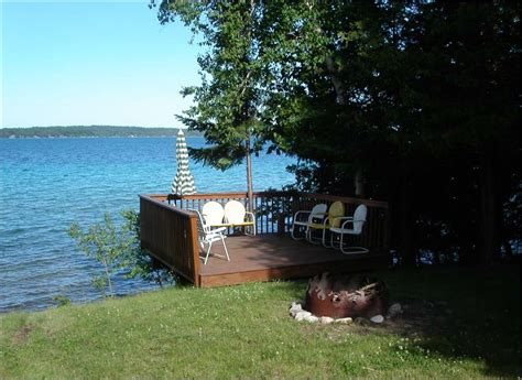 torch lake cottages torch lake cottage 3 bedroom lakefront w dock sleeps 9