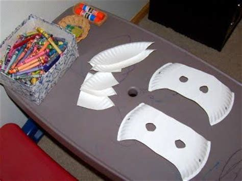 How To Make Masks Out Of Paper Plates - decorate a paper plate with stickers and crayons and then