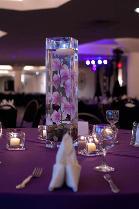 diy wedding centerpiece square vase with river rock