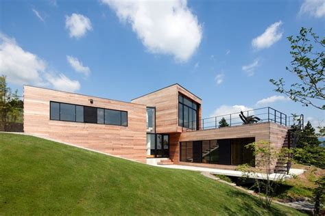 modern house building innovative modern wooden house on the slanted land with