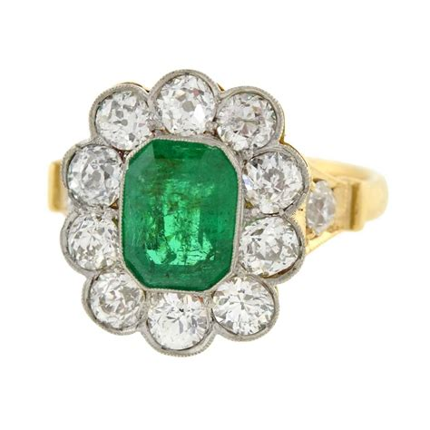edwardian emerald gold platinum cluster engagement