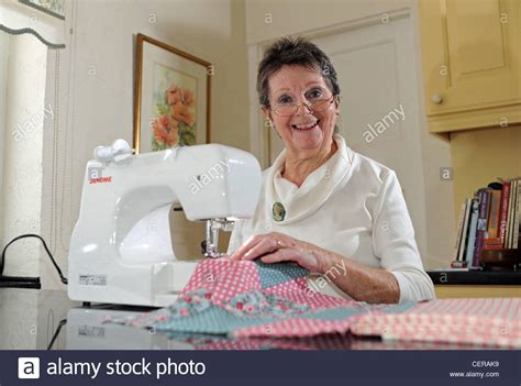 older ladies sew in mature woman in her 70s using a janome sewing machine
