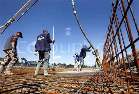 the swing site people working on construction site stock photo colourbox