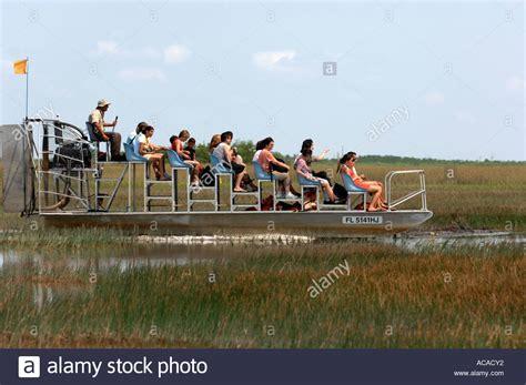airboat rides everglades national park tourist on airboat ride gator park miami in the everglades