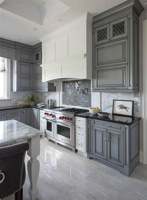 dark gray kitchen cabinets white kitchen hood with dark gray mosaic cooktop