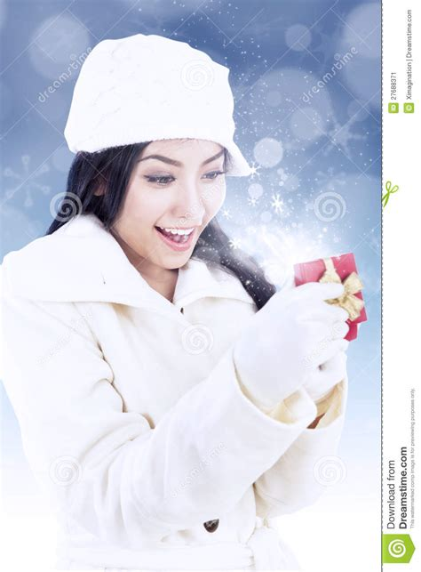 excited lady open christmas gift box  blue light stock image image