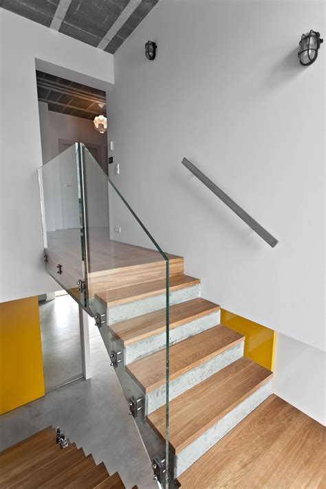 home interior design steps interior concrete staircase with wooden steps and glass railing panels of plus concrete