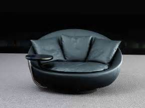 most comfortable reading chair black leather round living room chair with grey cushions and round built in side table on black
