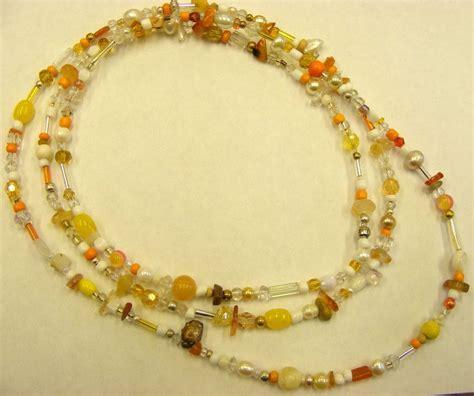 yellow beaded necklace beaded necklace orange yellow