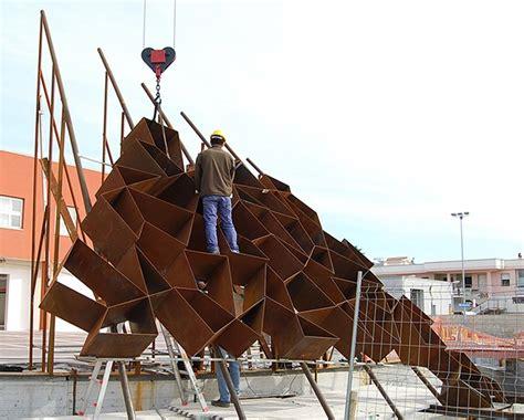 designboom italy address toti semerano constructs an irregular corten steel wall in