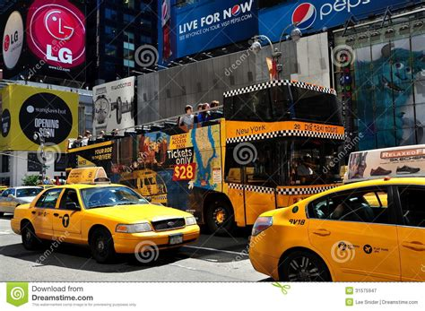 Square 1099 by Nyc Taxis And Tour Bus In Times Square Editorial