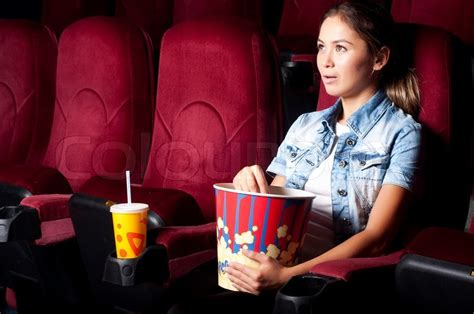 film ggs goes to bali young woman sitting alone in the cinema and watching a