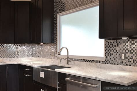 espresso kitchen cabinets with backsplash espresso cabinet white countertop metal backsplash