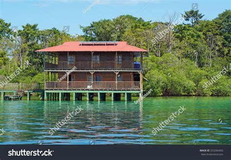 house over water off grid caribbean house over water stock photo 253260403