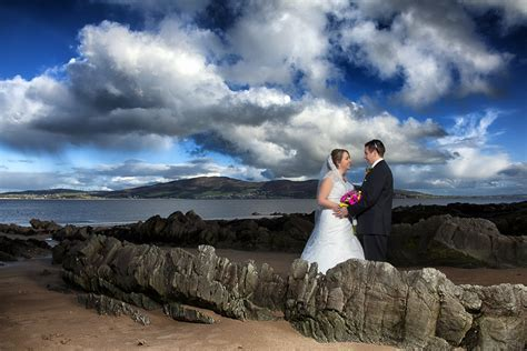 donegal wedding photographers couple on rathmullan beach